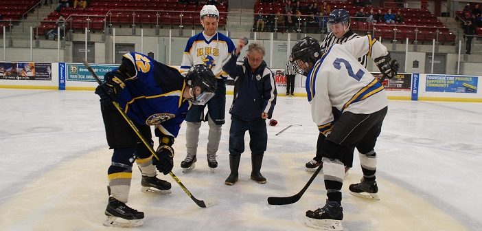Bradley Brandt drops the puck at a HHS student vs staff game