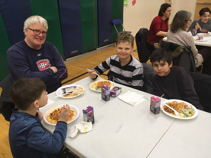 Yummy spaghetti gives (from left) Aaron, Doug (Grandpa), Jackson, and Darius something to smile about (supplied)