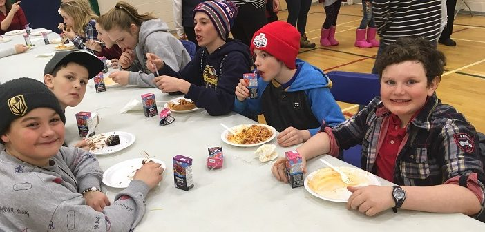 (Foreground from left) Kai, Hunter, Noah, Jared, and Jonah enjoy the annual HPS spaghetti dinner (supplied)