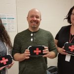 (From left) pharmacist Kelly Coker, public health RN Doug Ironside, and emergency department RN/team lead Kristin Cazabon with naloxone kits being dispensed at MAHC emergency departments (supplied)