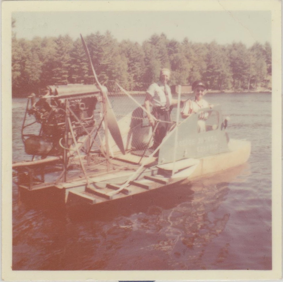 Dan Watson in the airboat he built (the woman with him is unknown)