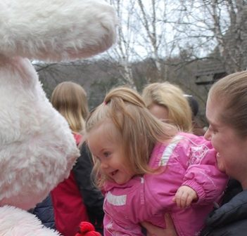 Hayley Scott, 1.5 years, leans in for a hug from the Easter bunny