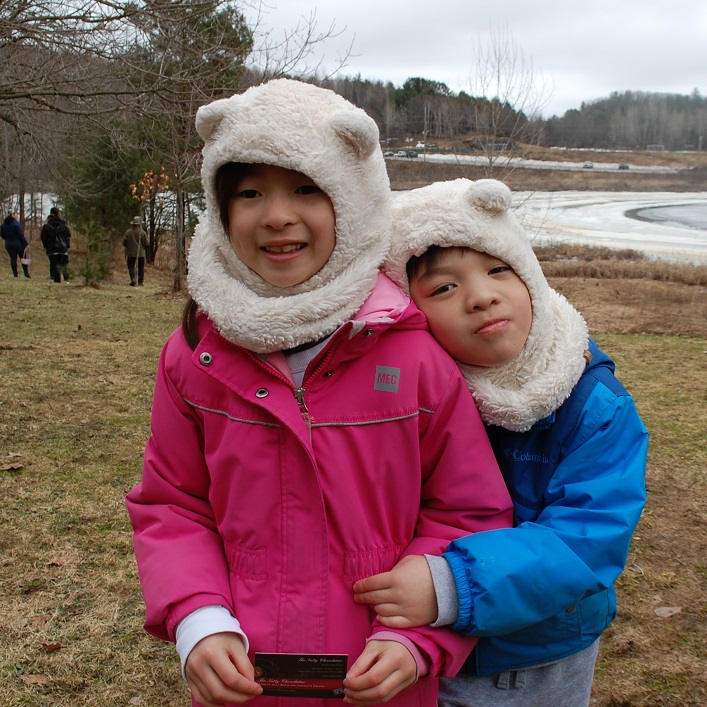Emily (left) and Isaac Lu found a golden egg, and got a card for a special treat at the Nutty Chocolatier