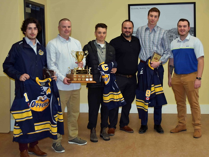 Retiring Otters players with their coaches (from left) Tyler Gervais-Rolfe, co-coach Marc Gagnon, Nathan Delarosbil, co-coach Brent Tomlinson, Cole Gilligan, and Jr C Otters president Monty Clouthier