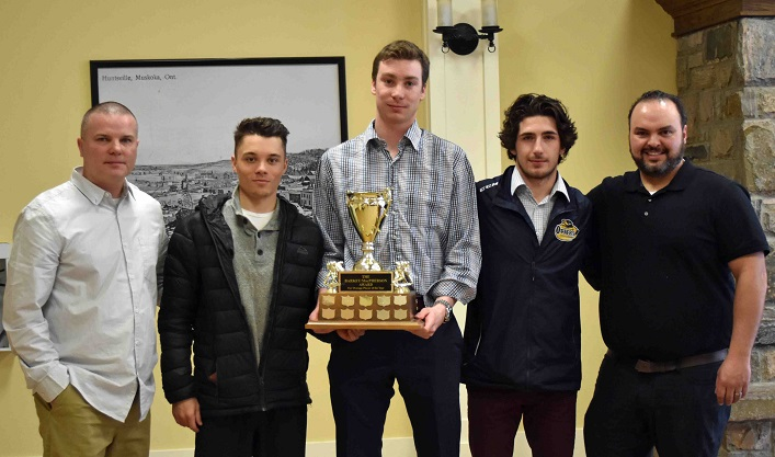 Barkey/MacPherson Award for retiring/overage players (from second left) Nathan Delarosbil, Cole Gilligan and Tyler Gervais-Rolfe