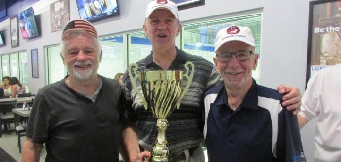 Barry Gonneau, Adrian Musters, and David Mallette with the 70+ Cup and championship hats