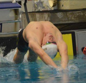 Mitchell Cox in a 100M Backstroke race (Photo: Cassandra Drescher)