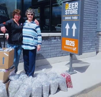 Nicole Bower (left), an employee at The Beer Store, and Karen Hewitt, a volunteer with the Friends of Fairvern, with some of the tabs collected