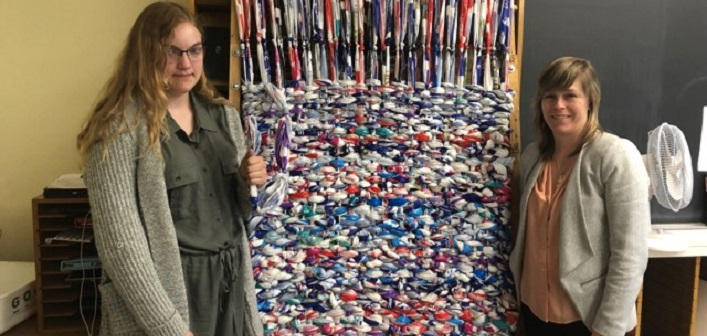 HHS student Caitlynn Flavell (left) and teacher Teresa Patterson with a milk bag mattress made by students
