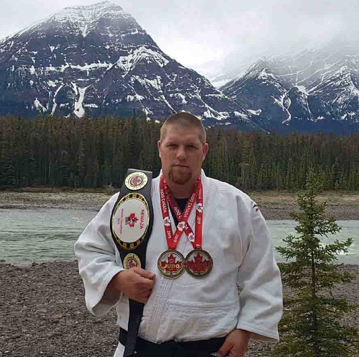 Jeff Allen with his latest gold medals and gold belt (supplied)