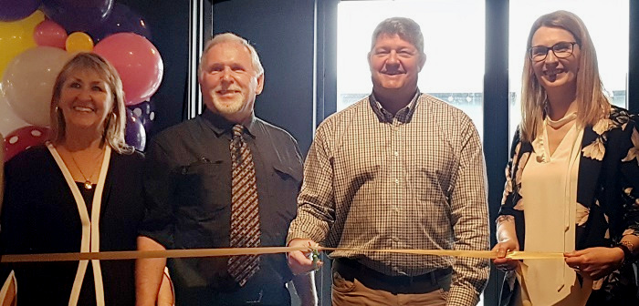 Mayor Scott Aitchison (second from right) cuts the grand opening ribbon with (from left) owners Terry and Hubert Lawrence and showroom manager Lindsay Cowan
