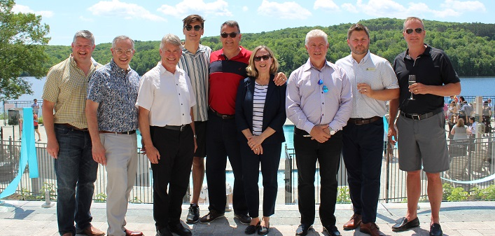 Celebrating the grand opening of Deerhurst's Lakeside Lodge with a ribbon-cutting are (from left) Mayor Scott Aitchison, MP Tony Clement, MPP Norm Miller, Brandon Waterhouse, great-great-grandson of Deerhurst founder Charles Waterhouse (not pictured is Brandon's brother, Ryan), siblings Bob and Sally Waterhouse, great-grandchildren of Charles Waterhouse, Paul Mondell, Senior Vice President, Development at Skyline Investments, Jesse Hamilton, General Manager of Deerhurst Resort, and Blake Lyon, CEO of Skyline Investments (Dawn Huddlestone)