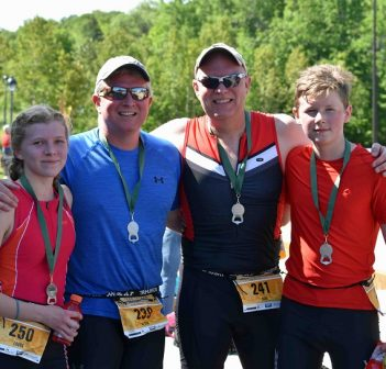 These dads brought their children along this year as first time Try a Tri athletes (from left) Laura, Peter, Dion, and Colin Yungblut