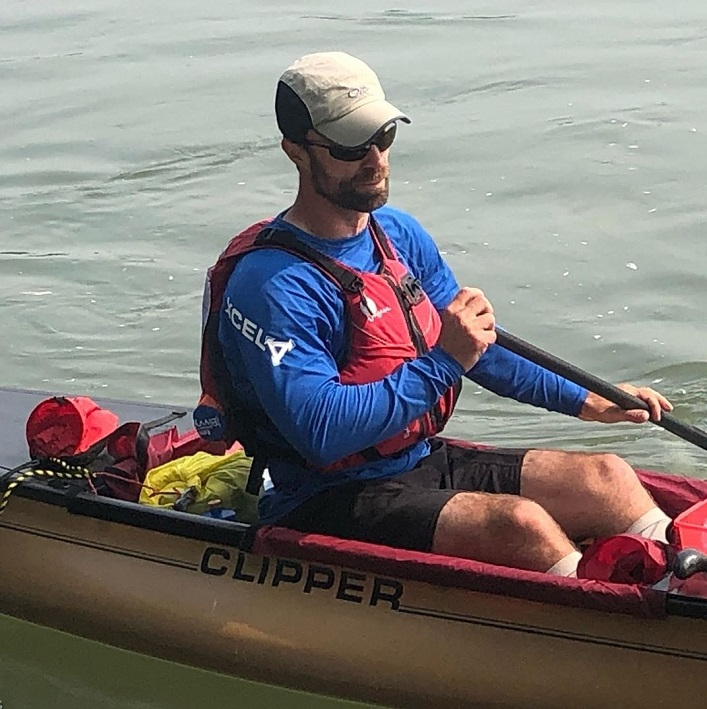 "Chris Near is ""destroyed but determined"" when he arrives at the Carmacks checkpoint just over 24 hours into the Yukon River Quest (Rebecca Francis)"