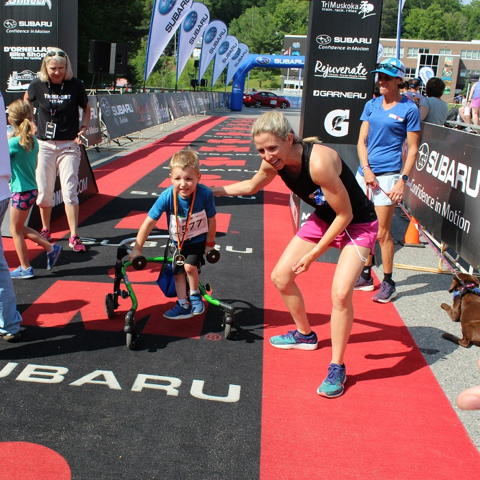 Participants, like this young IronKid, were all smiles when they crossed the finish line