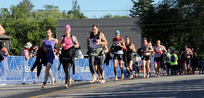 Ironman Muskoka 70.3 Triathletes make their way to the transition area following the swim (Photo by Don McCormick)
