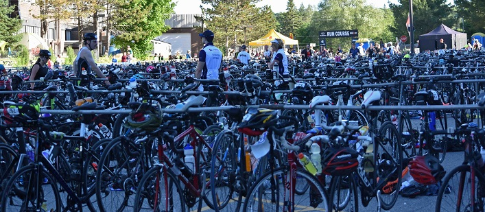 Bikes await their athletes in the transition area