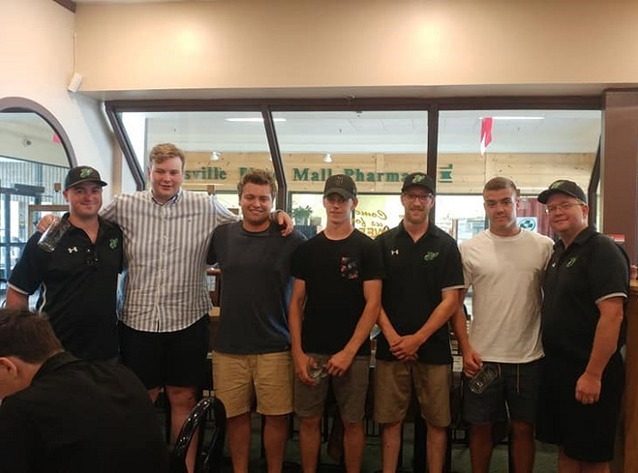 The team said thank you and good bye to the over-agers (from left) Sam Stewart, Mitch Jones, Cody Purvis and Cody Jones, who played their final season of LAX with the Junior C Hawks. Each player received a personalized mug.
