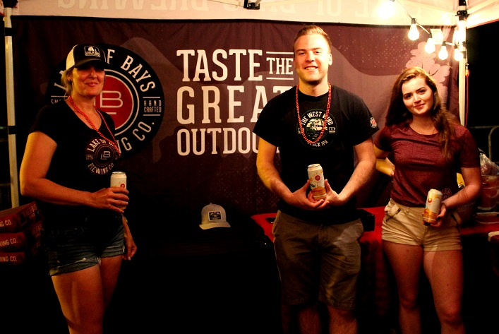 (From left) Mel Mercier, Tyler MacKay and Megan Starbuck served up cold brews at Huntsville Brewhouse beer garden, a new addition to this year's Midnight Madness
