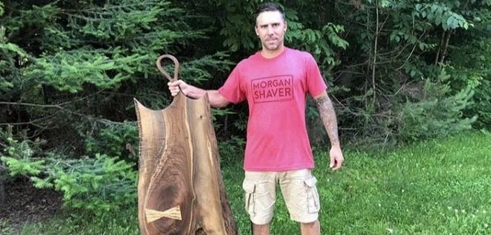 Morgan Shaver with one of his favourite pieces, a large black walnut charcuterie board (supplied)