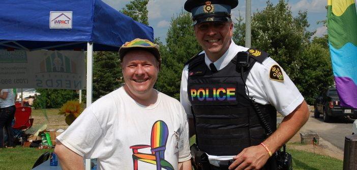 Muskoka Pride Festival organizer Shawn Forth with Huntsville OPP Detachment Commander John Graham at a past launch party (Doppler file photo)