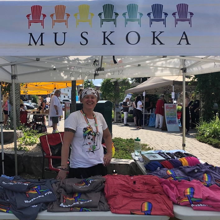 Volunteer Kate Quinlan selling merchandise