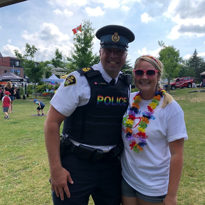 Caitlin Griffin with Huntsville OPP Detachment Commander John-Paul Graham, who said he wishes he could wear the rainbow badge at work every day
