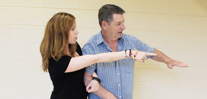 Tasha Bryant (left) and Ian Crowley talk choreography for Huntsville: A Choral History