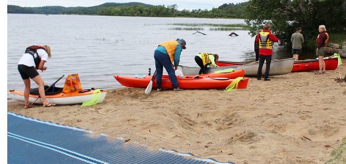 Paddlers ready their boats for the event