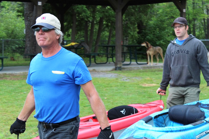 Paul McKinnon and Robert Edmonstone carried the paddlers canoes and kayaks to the water at Hutcheson Beach