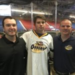 Tye Lindeman (centre), with Jr C Otters GM Britten Coffin and coach Marc Gagnon, is the team's assistant captain this year