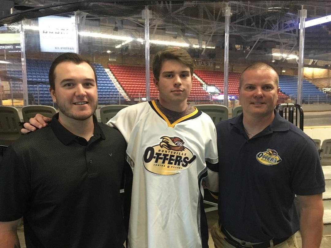 New player Cole Goode (centre), with Jr C Otters GM Britten Coffin and coach Marc Gagnon