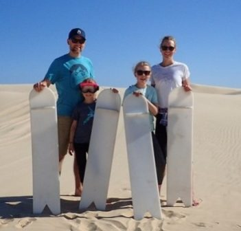 The Hallman family (from left) Andrew, Ellie, Joan and Mara tried sandboarding for the first time in Australia (supplied)
