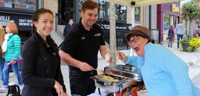 Jennifer Jerrett samples Huntsville Brewhouse's mac n cheese with Hilda Chan and Luke Murphy