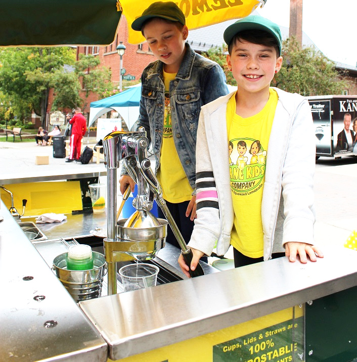 Two of the Kane triplets, Sadie (left) and Lila (Violet had to leave early to go to a practice), served up lemonade with a portion of sales going to Huntsville Festival of the Arts