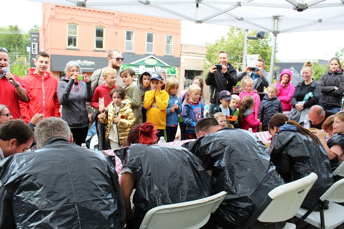 The pie-eating contest drew a crowd to the Town Hall steps