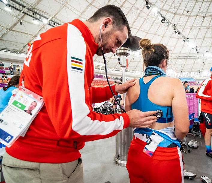 Dr. Rich Trenholm examining a member of the Canadian cycling team at the Para Pan American Games in Peru (supplied)