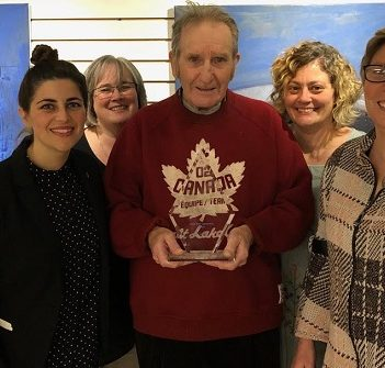 Rex Malloy (centre) with (from left) Marcy Galipeau of Community Living Ontario and Diane Lupton, Camille Barr, and Suzanne Willett of Community Living Huntsville