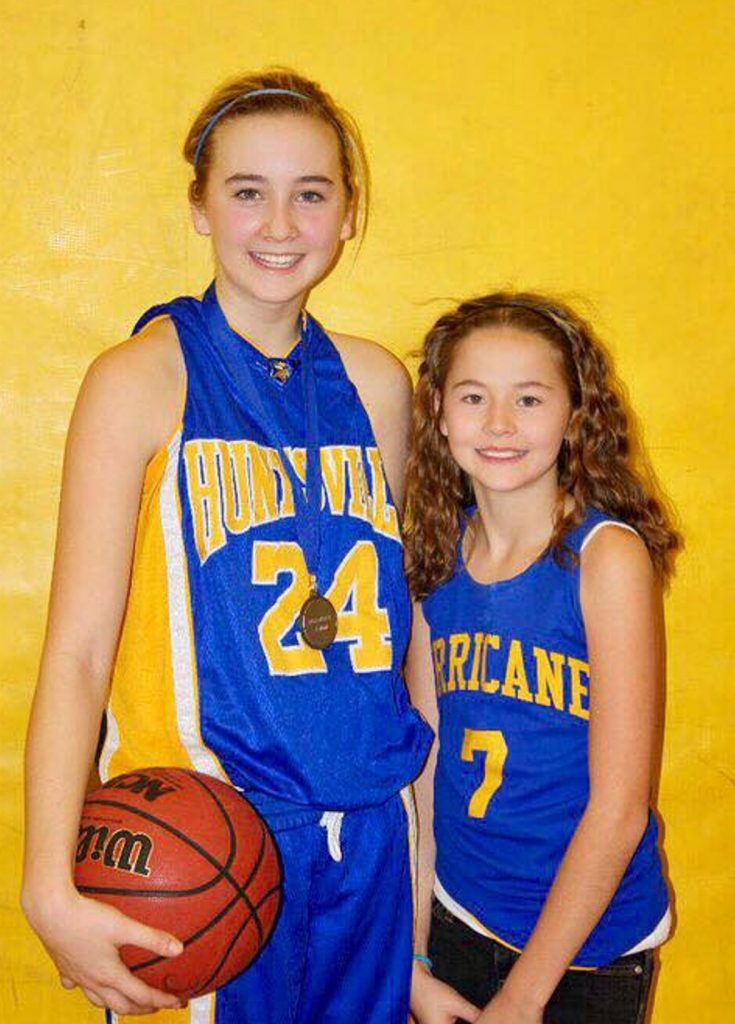 The McAlpine sisters early in their basketball careers: Taylor (left) in grade 9 as a Huntsville Hoya and Emma as a Huntsville Hurricane (supplied)
