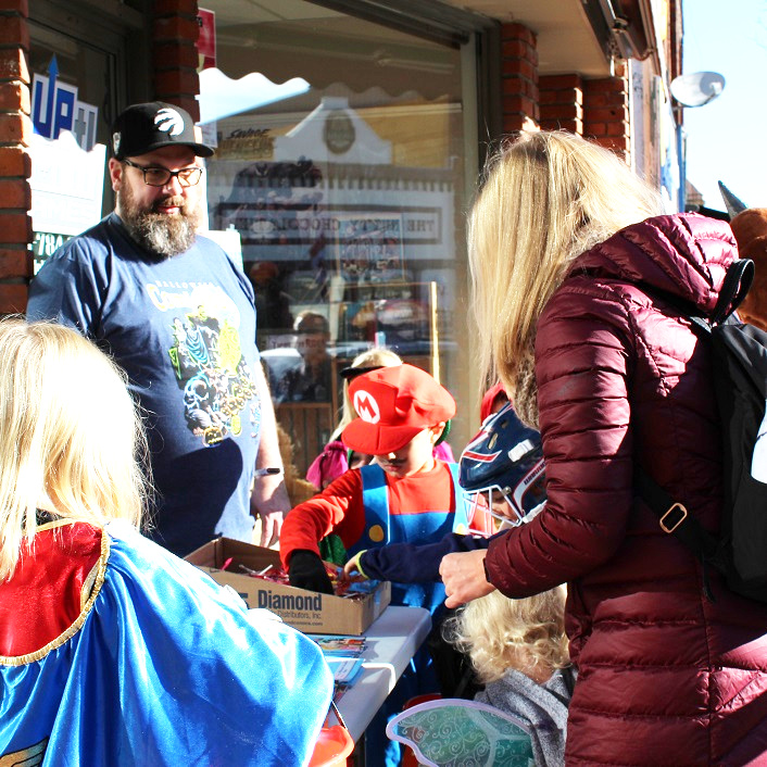 Trick-or-treaters at Up North Games could choose a treat or a comic book