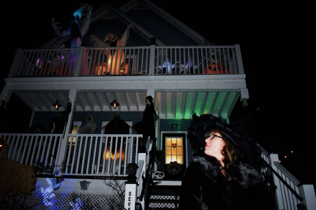 For Kandis Sinister, embracing the darker side of life has allowed her to express her love for all things strange and unusual. Here, she sits in front of her Florence Street East home she shares with her husband Troy. They might get close to 200 candy-seeking kids tonight.