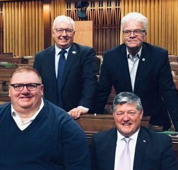 MP Scott Aitchison (front right) with Bracebridge Mayor Graydon Smith beside him, District Chair John Klinck behind him, and Bracebridge Deputy Mayor Rick Maloney. All three attended Aitchison's swearing-in ceremony in Ottawa. (submitted)