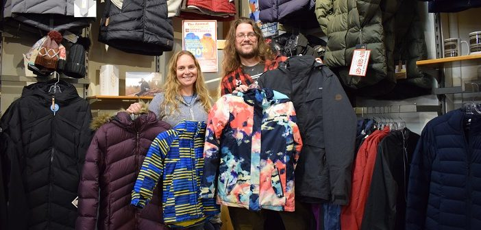 Heather Cassie and Randy Mitson with some of the coats already donated to the annual AO winter coat drive