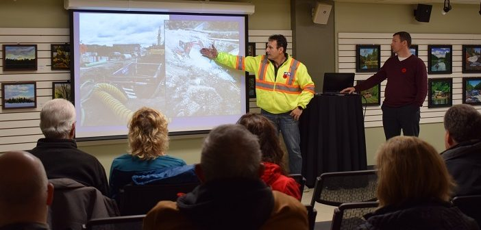 John Bravakis (left), J.B. Enterprises, and Mark Misko, District of Muskoka, talk to residents and business owners about some of the setbacks of the King William Street Project. (Mandi Hargrave)