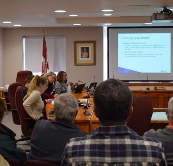 Kris Hadley of Hutchinson Environmental Ltd. speaks to those gathered at the Huntsville council chambers on Nov. 8, 2019, about the pilot study (Tamara de la Vega)
