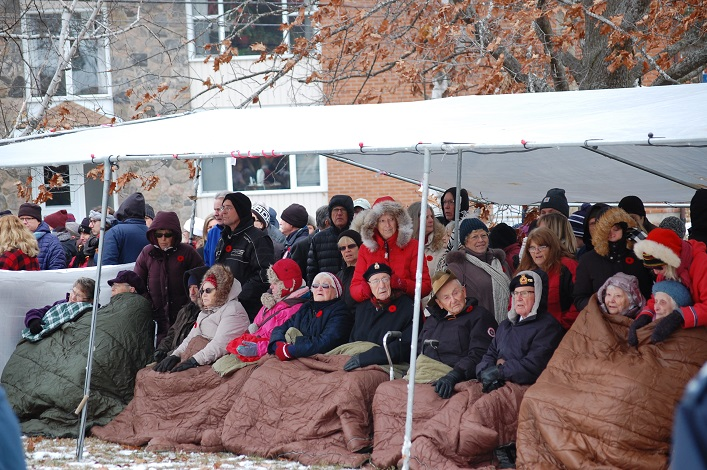 Veterans and their families await the start of the 2019 Remembrance Day service (Dawn Huddlestone)