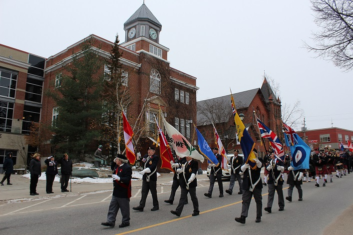 The Huntsville Legion's Colour Guard salutes dignitaries during the Remembrance Day parade as it passes by Town Hall (Dawn Huddlestone)
