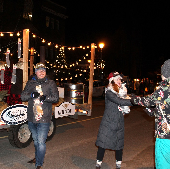 Some lucky parade goers got warm woolen socks from Valley Feeds
