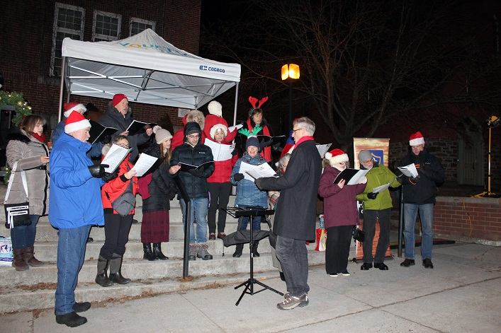 The Huntsville Community Choir warmed up the crowd with some carols