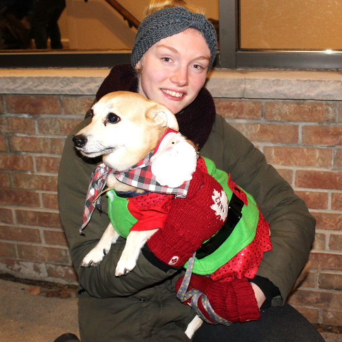 Milo, with owner Kaila Forbes, dressed for the occasion, ready to jump into action if Santa needed another elf